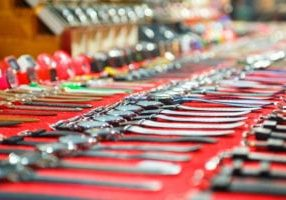 A row of watches for sale by the side of the road says counterfeit. But Amazon Prime Day counterfeiting is a bigger-scale problem.
